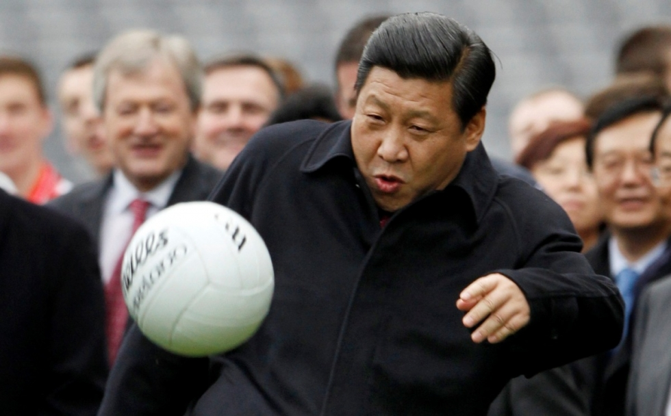 president-xi-jinping-kicks-a-football-during-a-u-k-visit